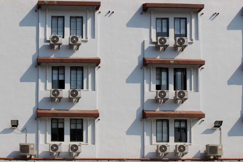 a building with multiple air conditioners