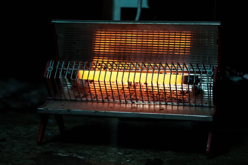 A radiant heater placed on the floor
