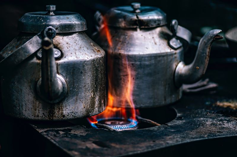 kettle of tea placed on a stove