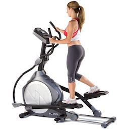 working out on a cross trainer to lose weight