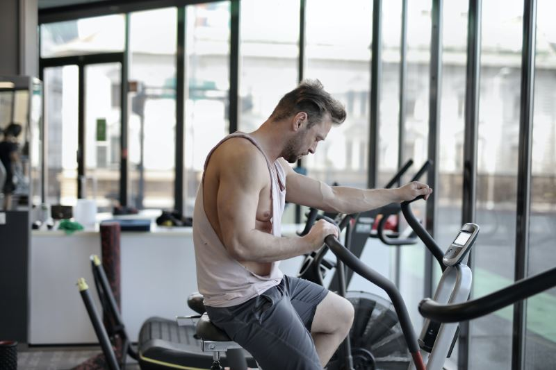 exhausted man training on exercise bike