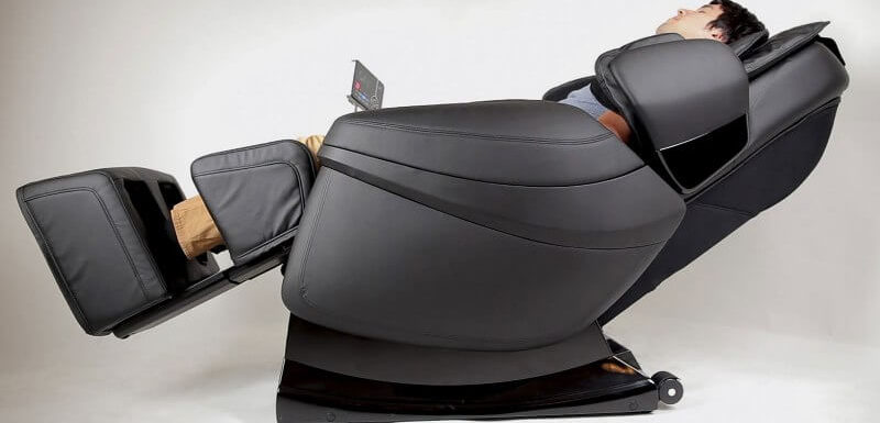 A man relaxing on a massage chair